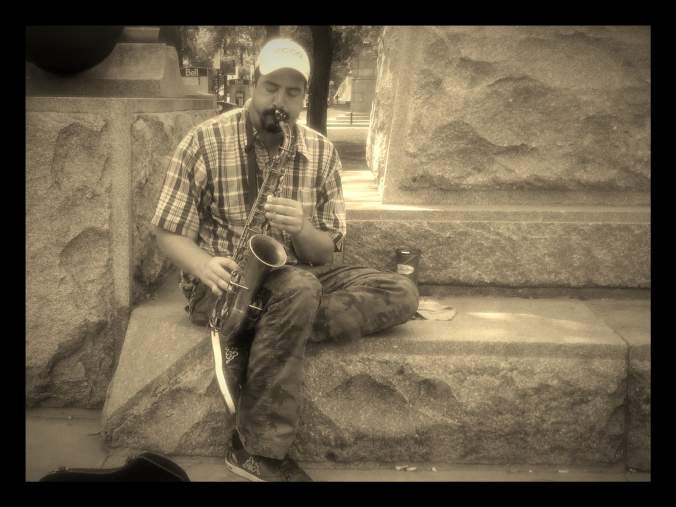 Playing his old sax at the base of a Sir John a. MacDonald monument in Gore Park. Photo Credits: Me :)