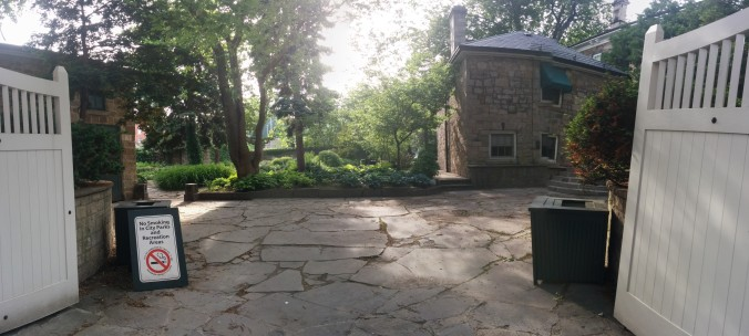 Upon turning onto MacNab street you are greeted with an open gate and an inviting backyard garden.