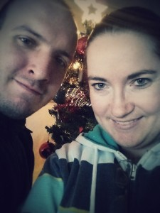 The hubby and I by our Christmas tree. our second Christmas as a family <3